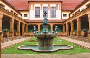Fountain in limestone and bronze in a courtyard by Heinrich Jobst and Julius Scharvogel, 1910. Bad Nauheim